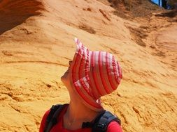 girl in a pink hat on a background of mountains in Roussillon