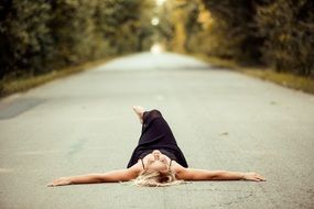 girl laying on the asphalt