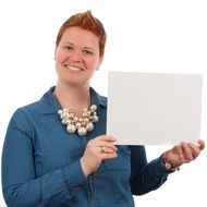 woman with short red hairs holding whiteboard