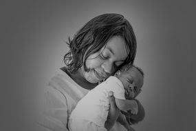 black and white portrait of mother with baby