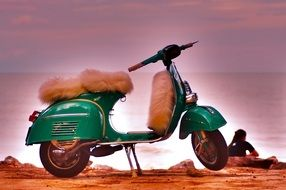 green scooter with a fur seat