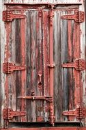wooden door of the old barn close up