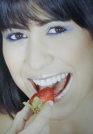 portrait of a model eating strawberry