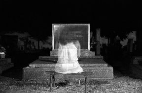 ghost on a grave in a cemetery