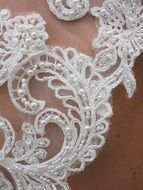 White beads on a Wedding Dress