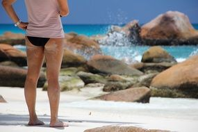 woman standing on beach in Seychelles