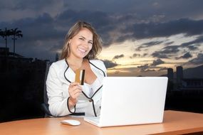 business woman at the table with laptop