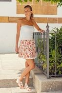 young woman in floral skirt in gran canaria