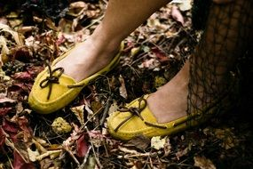 girl legs in yellow moccasins