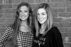 black and white photo of two young models