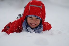 boy having fun with snow