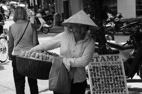 asian woman with full basket, Street Trading, Vietnam, Saigon
