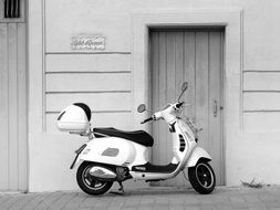 white scooter on a city street