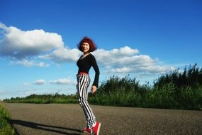 red hair woman with striped pants