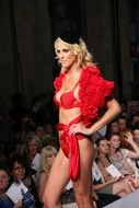 erotic model in red lingerie on the catwalk