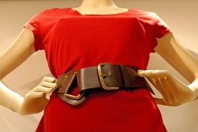 red dress with a leather belt on a mannequin