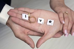 "word ""love"" in the hands of the newlyweds"