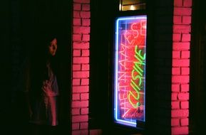 woman near the neon sign