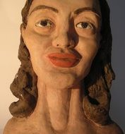 sculpture of a woman with red lips