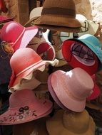 sun hats on a store counter
