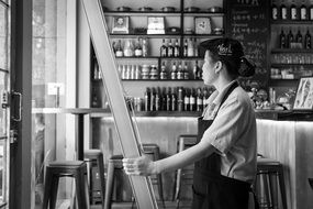 black and white photo of the worker in a restaurant