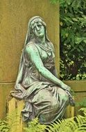 bronze sculpture of a woman on the grave