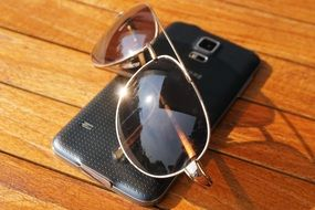 sunglasses and smartphone