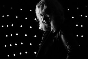 blonde Woman in front of Spotlights, black and white