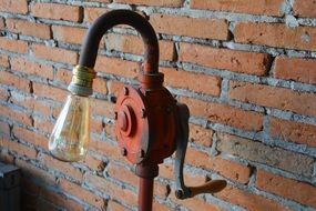 old lamp near the brick wall