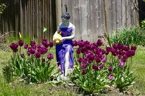 woman with jug on flower bed, Garden Sculpture
