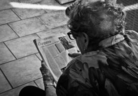 black and white photo of a grandmother with a newspaper