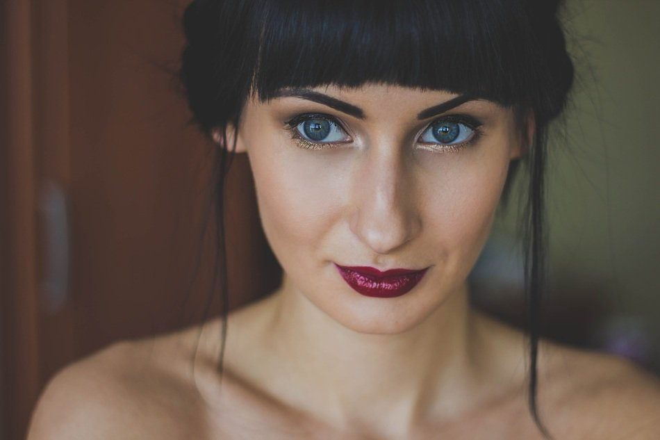 Portrait of a girl with dark lipstick on her lips