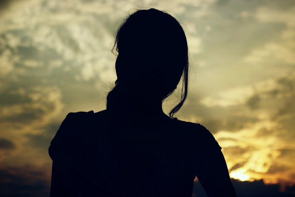 Dark Woman Silhouette at Sunset sky