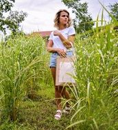 walking girl in a field in summer