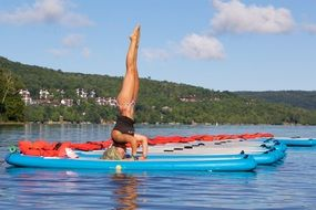 doing girl yoga on water