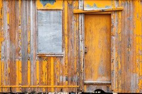 yellow weathered wooden wall