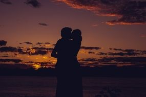 couple in love at a romantic sunset