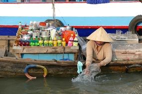 Man on the boat on Mekong river in Vietnam