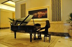 woman playing piano in Emirates Palace palace