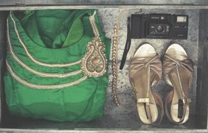 green dress, golden boots and camera