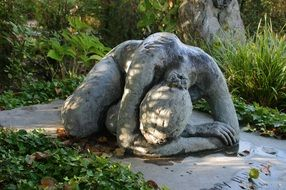 woman suffering stone sculpture