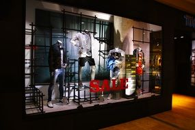 mannequins in a showcase in night lighting