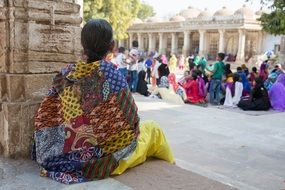 traditional dressed Indian woman sits at Temple