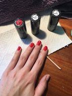 manicure with red polish