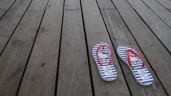 beach slippers on the plank floor