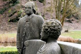 Stone figures of man and woman in the park