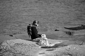 lonely woman meditates on the coast