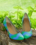 blue and green Shoes on high Heels outdoor