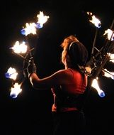 woman juggles with lights