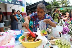 elderly woman in a market in mexico